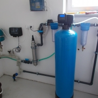Water treatment plant in a family house – from left: pressure vessel, control unit, UV lamp, tube filters, fiberglass automatic filter.
